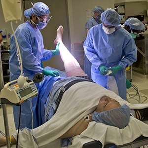 A man on a surgery table in the OR